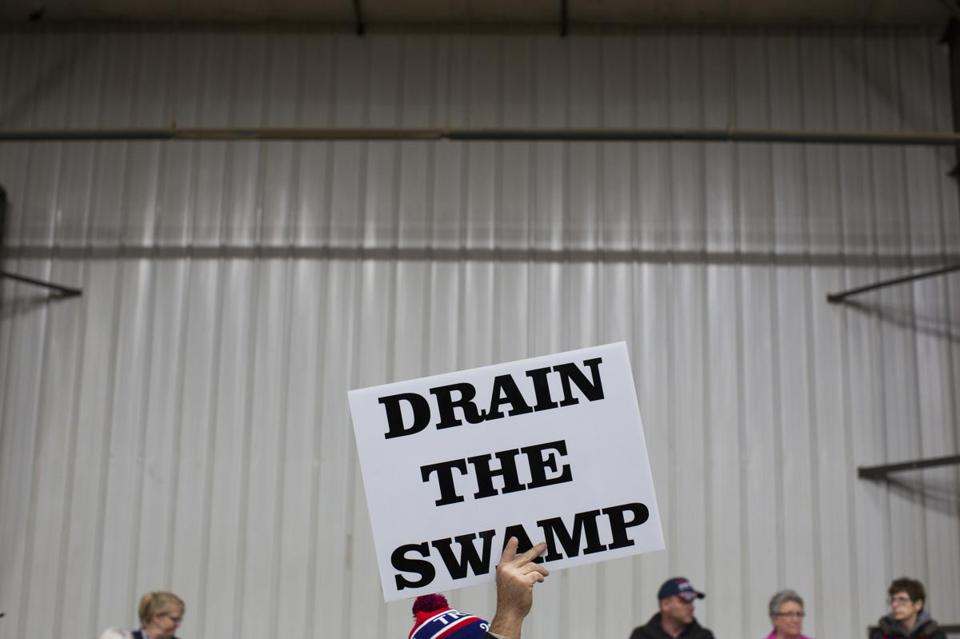 "FILE - In this Oct. 27, 2016, file photo, supporters of then-Republican presidential candidate Donald Trump hold signs during a campaign rally in Springfield, Ohio. Despite President Donald Trump's campaign to ""drain the swamp"" of lobbyists and special interests, Washington's influence industry is alive and well _ and growing. Former members of the Trump transition team, presidential campaign, administration and friends have set up shop as lobbyists and cashed in on connections, according to a new analysis by Public Citizen, a public interest group, and reviewed by The Associated Press. (AP Photo/ Evan Vucci, file)"