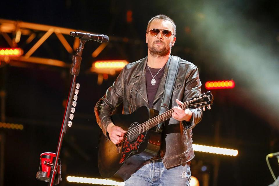 "FILE - In this June 10, 2016 file photo, Eric Church performs at the CMA Music Festival at Nissan Stadium in Nashville, Tenn. Country star Church struggled to hold back tears in a tribute to the victims of the mass shooting at a country music festival in Las Vegas and debuted a song he wrote in their honor called ""Why Not Me."" Church was a headliner at the Route 91 Harvest Festival two days before a gunman opened fire on a crowd of thousands Sunday night, Oct. 1, 2017. (Photo by Al Wagner/Invision/AP, File)"
