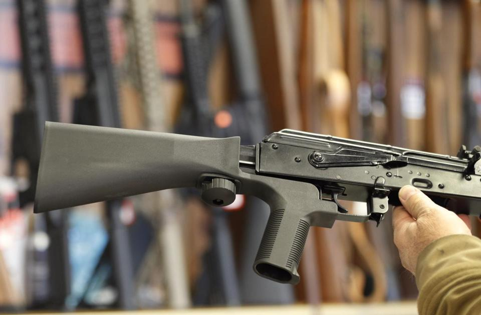 A bump stock device installed on a semiautomatic weapon is shown in a gun store in Salt Lake City, Utah.