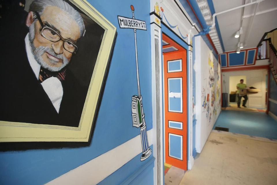 A mural that featured Theodor Geisel, left, also known by his pen name Dr. Seuss, rested on a wall near an entrance at The Amazing World of Dr. Seuss Museum, in Springfield, in May.