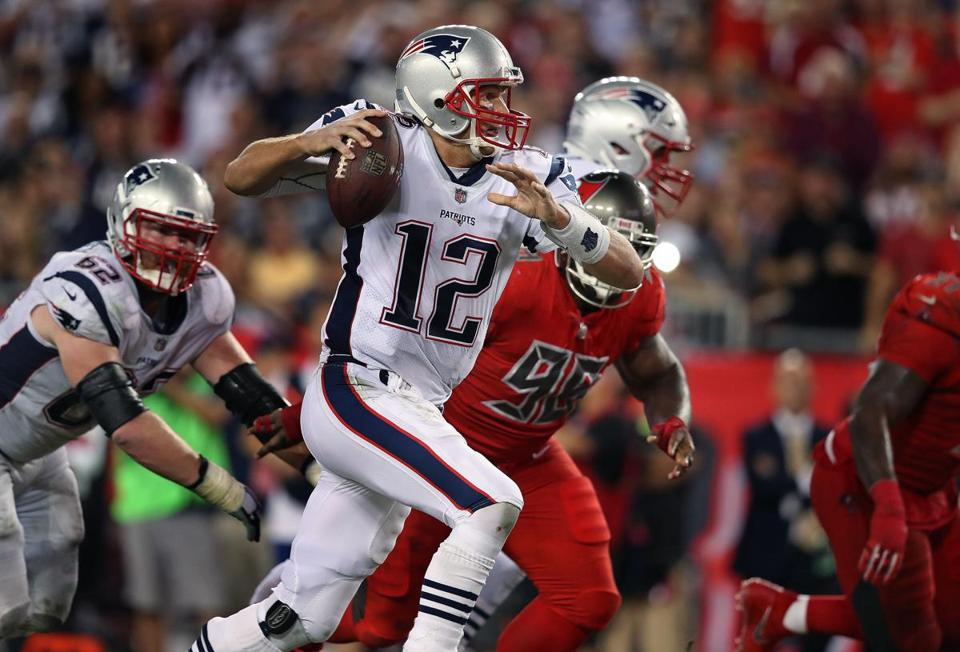 Tampa, FL: October 3, 2017: Patriots quarterback Tom Brady scrambles for some yardage late in the first half that helped set up a field goal. The New England Patriots visited the Tampa Bay Buccaneers in a regular season Thursday Night NFL football game at Raymond James Stadium. (Jim Davis/Globe Staff).
