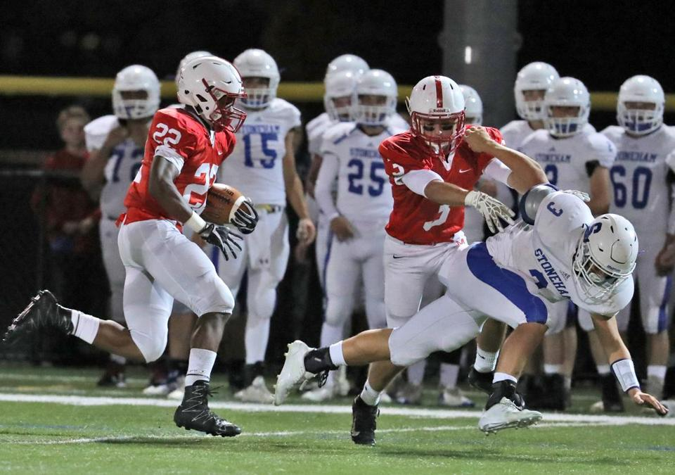 Melrose Ma 10/6/17 Melrose High Rey Guity returns a kick off 90 yards for a touchdown as teammate Louis Izzi Jr. makes the block on Stoneham High Tre Pignone to break him free during first half action at Melrose High. (Matthew J. Lee/Globe staff) topic 07schmelrose reporter Karl Capen