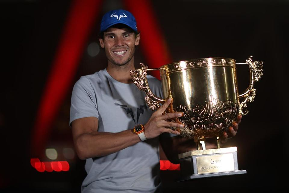 BEIJING, CHINA - OCTOBER 08: Rafael Nadal of Spain hold the winners trophy poses for a picture after winning the Men's Singles final against Nick Kyrgios of Australia on day nine of the 2017 China Open at the China National Tennis Centre on October 8, 2017 in Beijing, China. (Photo by Lintao Zhang/Getty Images)