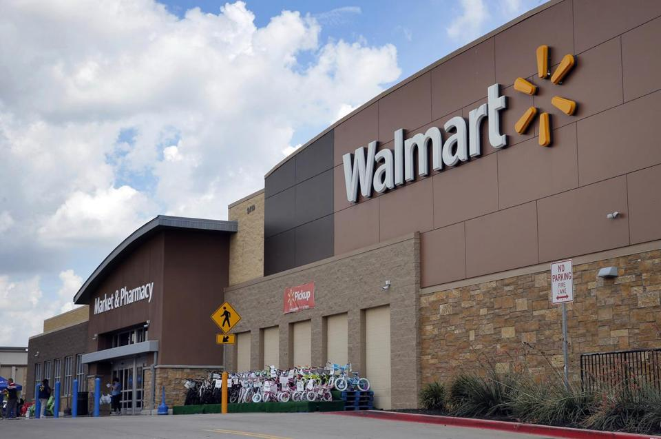 Walmart predicted net sales growth at or above 3 percent next fiscal year, driven partly by online sales.