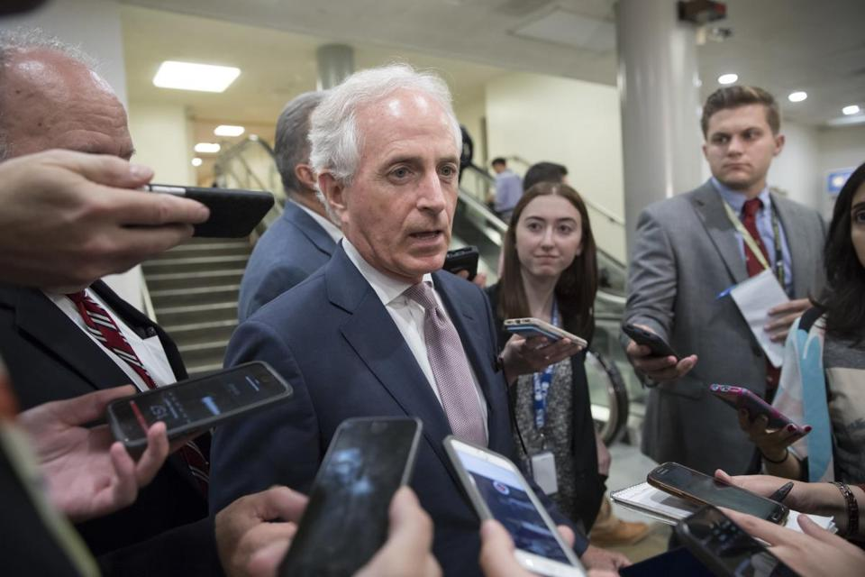 In this photo taken Tuesday, Aug. 1, 2017, Sen. Bob Corker, R-Tenn., chairman of the Senate Foreign Relations Committee, is met by reporters as he arrives at the Senate where the Republican health care bill collapsed last week due to opposition within the GOP ranks, on Capitol Hill Washington. Today, Tuesday, Oct. 10, 2017, President Donald Trump is lashing out at Bob Corker as 'Liddle Bob Corker,' continuing a feud with the Tennessee senator who called the White House and 'adult day care center' and warned Trump could put the nation on the path toward World War III. Stepping cautiously, fellow Republicans senators are avoiding taking sides in the dispute but calling on both sides to cool it down. (AP Photo/J. Scott Applewhite)