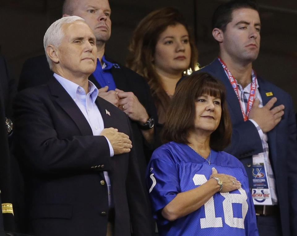 Vice President Mike Pence and his wife, Karen, stand during the playing of the national anthem before Sunday's 49ers-Colts game in Indianapolis.