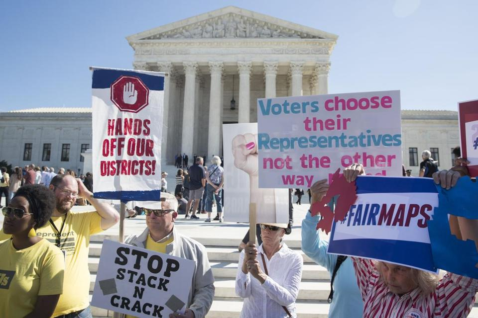 Mandatory Credit: Photo by (9111561k) People attend an anti-gerrymandering rally outside the Supreme Court after the Court heard oral arguments for the case Gill v. Whitford, in Washington, DC, USA, 03 October 2017. Anti-gerrymandering rally outside the Supreme Court, Washington, USA - 03 Oct 2017