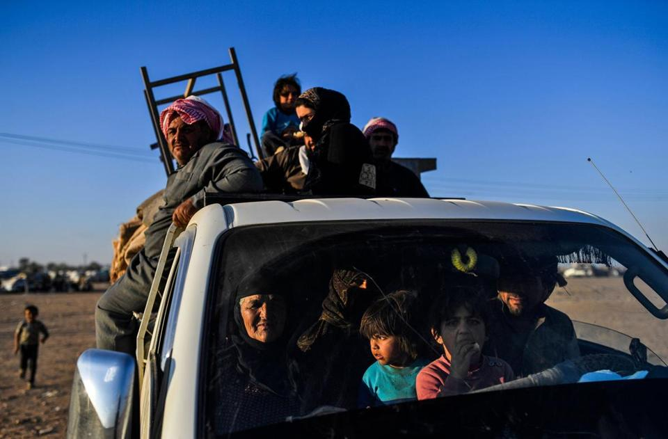 Syrians displaced from the city of Deir Ezzor arrive on the outskirts of Raqa on October 11, 2017. Talks are taking place on the safe exit of civilians trapped in Syria's Raqa, as US-backed forces prepare a final push to recapture the city from the Islamic State group. / AFP PHOTO / BULENT KILICBULENT KILIC/AFP/Getty Images