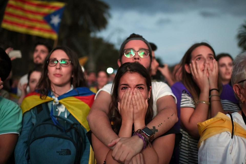 Pro-independence supporters watched Catalan President Carles Puigdemont announce that he will abide by the results of last week's referendum.