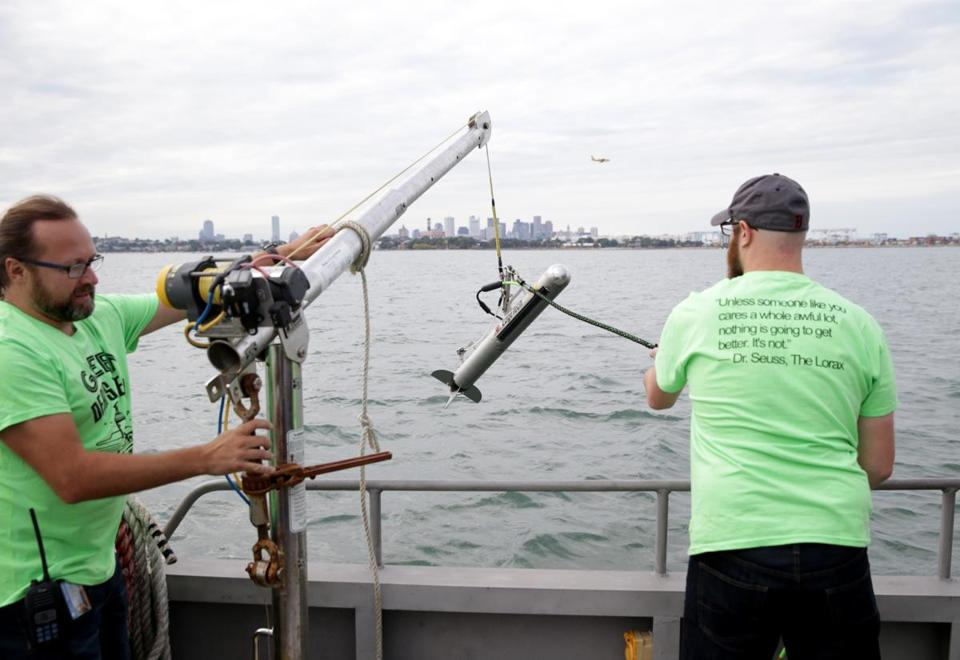 Francesco Peri, left, and Daniel Genest, right, aboard the M/V Columbia Point during during a HUBweek event Wednesday on technology and harbor health. Here they were deploying side scan sonar to demostrate their research.