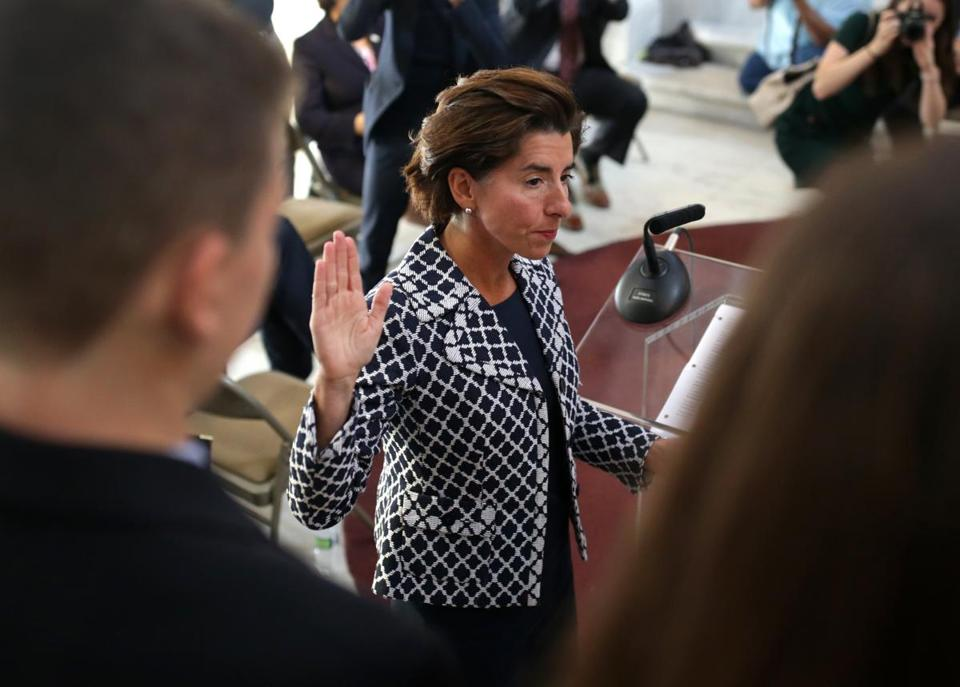 Rhode Island Governor Gina M. Raimondo giving the oath of office last week at a swearing in ceremony for Melissa A. Long (not pictured) as an associate justice of the Rhode Island Superior Court.