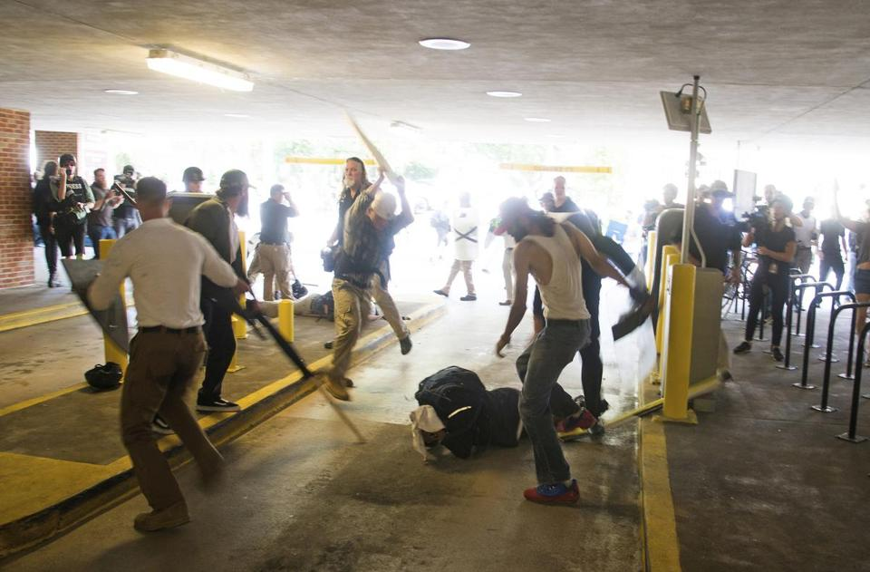 DeAndre Harris, bottom is assaulted in a parking garage beside the Charlottesville police station after a white nationalist rally was disbursed by police, in Charlottesville, Va., in August.
