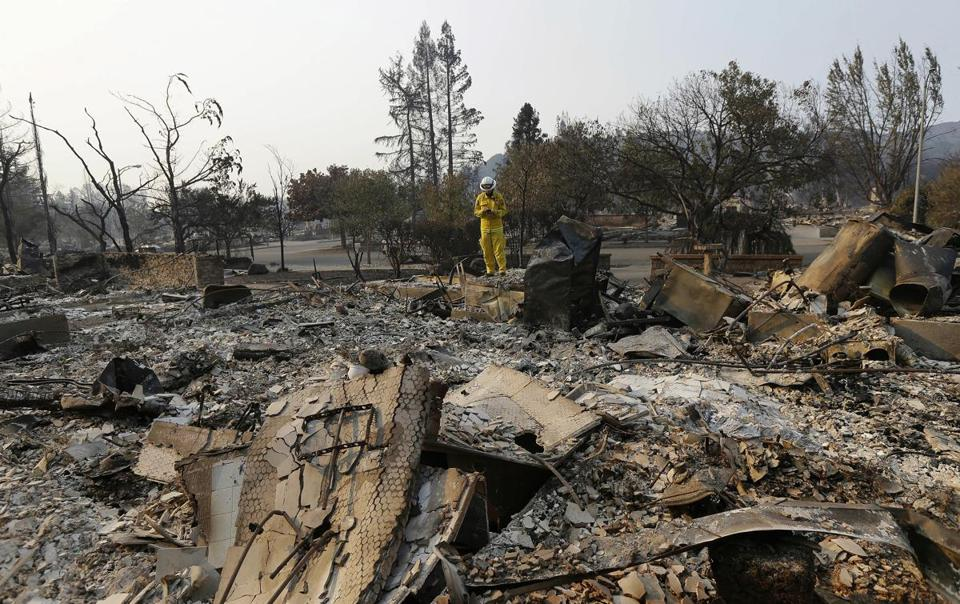 Cal Fire forester Kim Sone inspected damage at homes destroyed by wildfires in Santa Rosa, Calif., on Thursday.