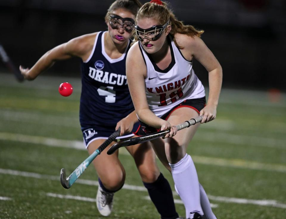 North Andover, MA: 10-11-17: North Andover's Meghan Moran (right) battles with Dracut's Jessica Conway (left) for control of the ball. Dracut visited North Andover in a high school field hockey game. (Globe Staff Photo/Jim Davis)
