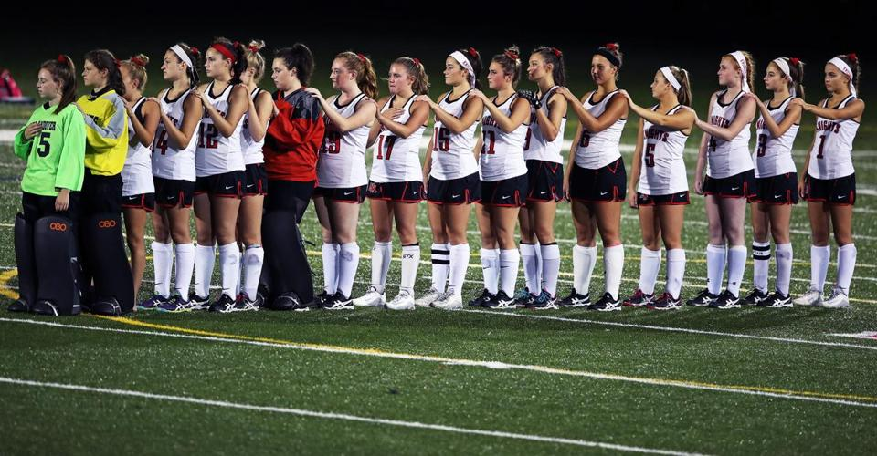 North Andover, MA: 10-11-17: The North Andover team is pictured lined up during the playing of the national anthem before the game. Dracut visited North Andover in a high school field hockey game. (Globe Staff Photo/Jim Davis)