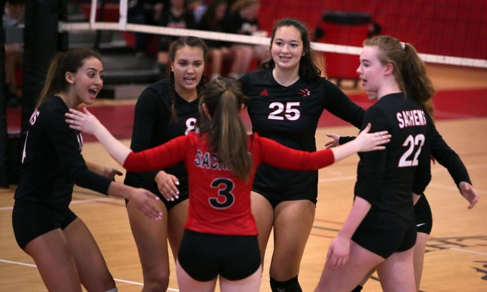 Winchester, MA: 10-11-17: Winchester players celebrate a first game point. Melrose visited Winchester in a high school girl's volleyball match. (Globe Staff Photo/Jim Davis)