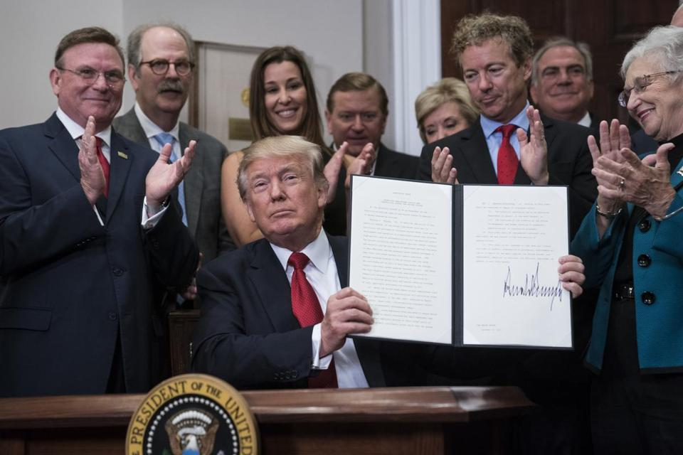 President Trump signs an executive order on health care the White House Thursday.