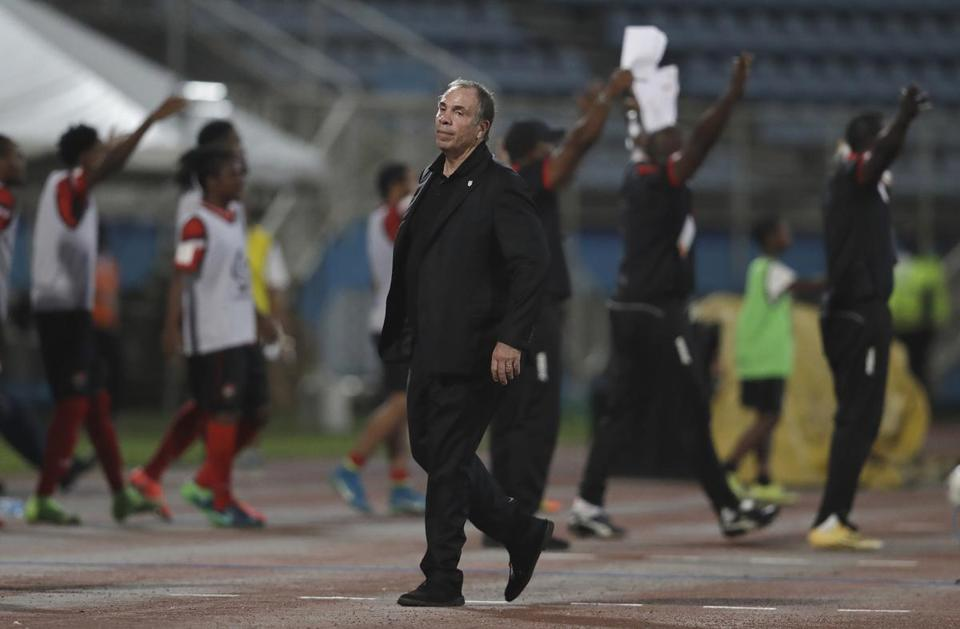 "FILE - In this Oct. 10, 2017, file photo, United States coach Bruce Arena stands on the sideline during a 2018 World Cup qualifying soccer match against Trinidad and Tobago, in Couva, Trinidad. Arena has resigned in the wake of the teams U.S. national team's crash out of contention for the 2018 World Cup. ""We didn't get the job done, and I accept responsibility,"" Arena said in a statement on Friday, Oct. 13, 2017. (AP Photo/Rebecca Blackwell, File)"