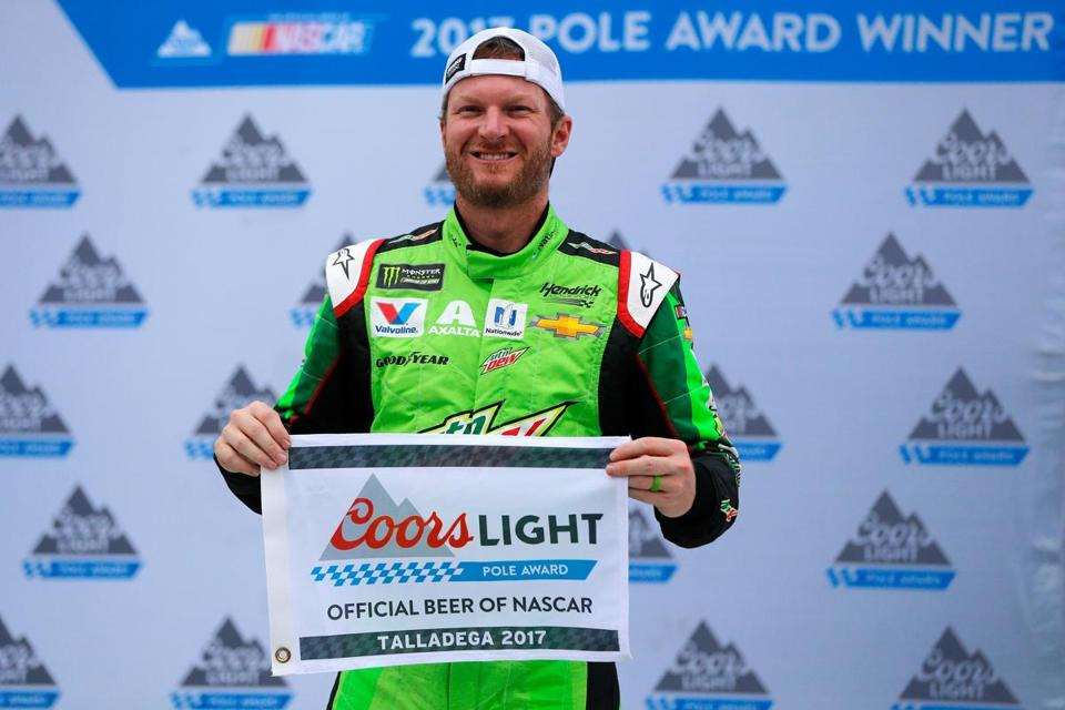 TALLADEGA, AL - OCTOBER 14: Dale Earnhardt Jr., driver of the #88 Mountain Dew Chevrolet, poses with the Coors Light Pole Award after qualifying in the pole position for the Monster Energy NASCAR Cup Series Alabama 500 at Talladega Superspeedway on October 14, 2017 in Talladega, Alabama. (Photo by Jonathan Ferrey/Getty Images)