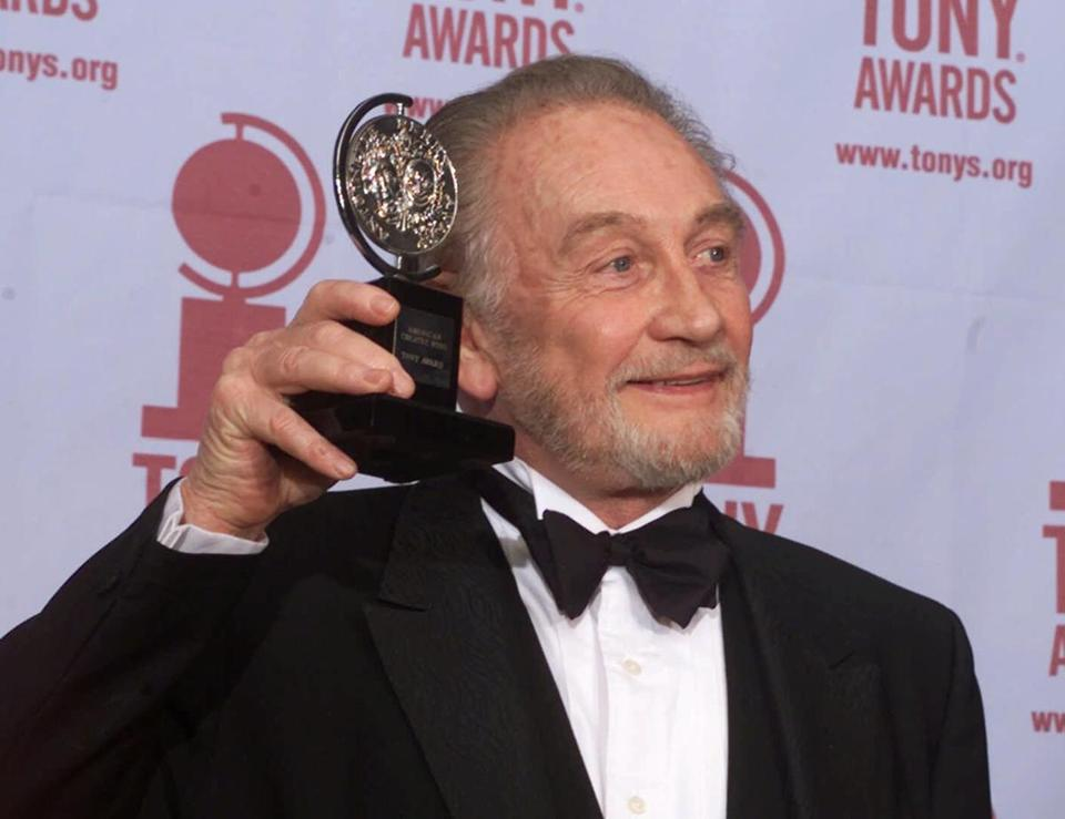 Roy Dotrice posed with a newly received Tony Award in 2000.