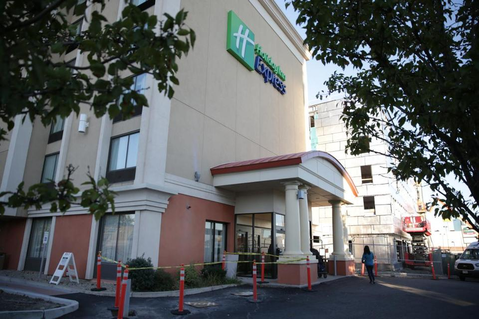 A man was shot and killed early Tuesday in the Holiday Inn Express hotel on Boston Street, officials said.