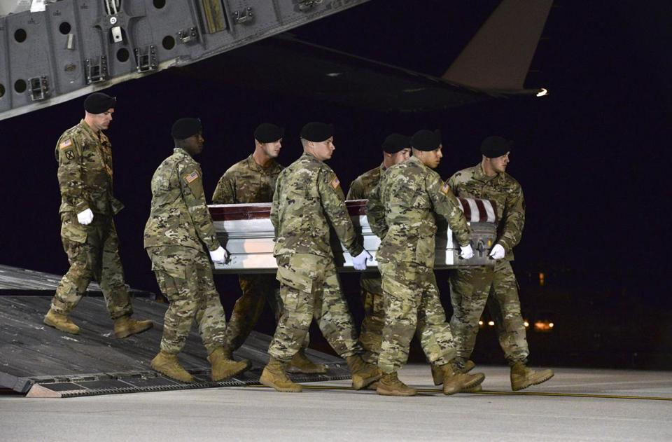 Army carry team transfered the remains of Army Staff Sgt. Dustin Wright of Lyons, Ga., upon arrival at Dover Air Force Base, Del. Wright, 29, of Lyons, Ga., was one of four US troops and four Niger forces killed in an ambush by dozens of Islamic extremists on a joint patrol of American and Niger Force.
