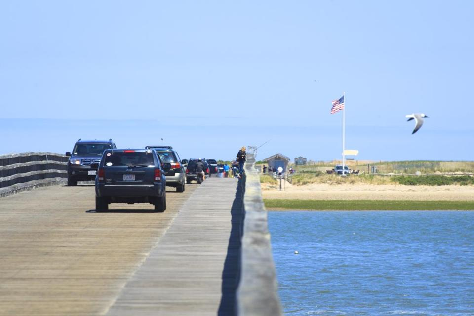 5/25/2014 - Duxbury, MA - Cars cross the Powder Point Bridge on their way to Duxbury Beach. Solar panels have replaced telphone poles on the shore, improving the view for motorists. Item: 22sobeach. Story by Jean Lang. Dina Rudick/Globe Staff.