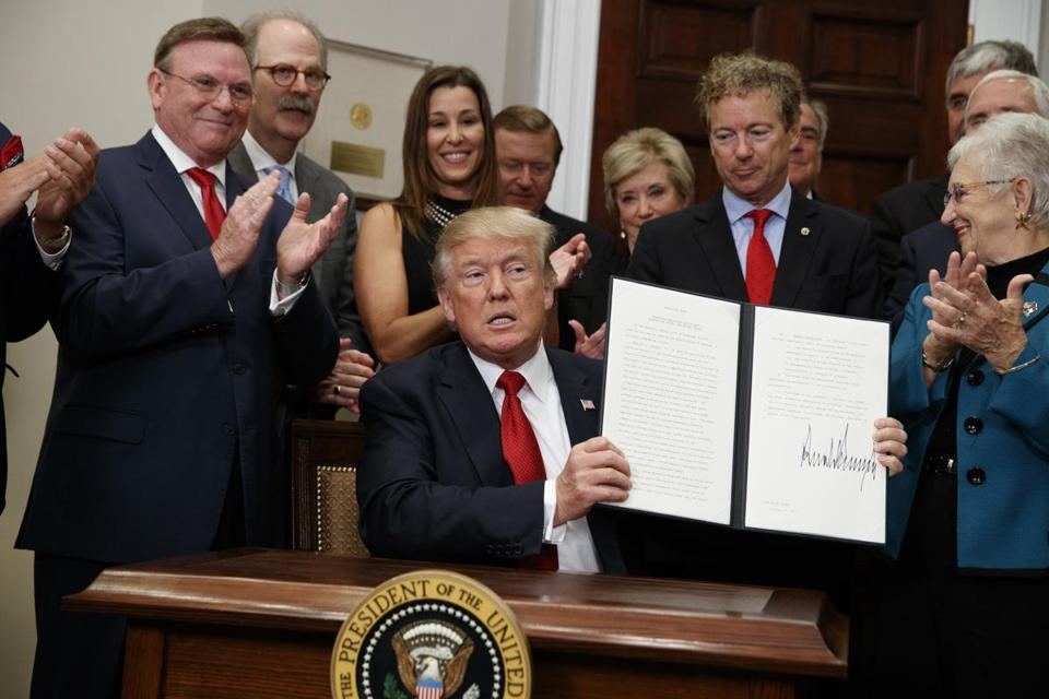President Donald Trump showed an executive order on health care that he signed last week.
