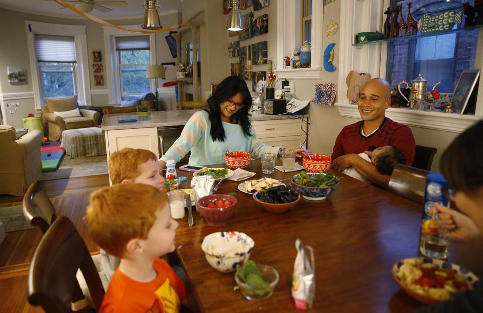 Brookline, MA -- 10/19/2017 - (L-R) Joel Lindy, 6, and his brother Alan, 4, share dinner with Alianette Andino, Kelvin Garcia and their daughter Amaia Andino Garcia and their mom, Gwen Taylor at their home in Brookline. Amaia had a serious heart condition called left ventricular dysplasia. She was rushed out of Puerto Rico to undergo lifesaving surgery at Children's Hospital. (Jessica Rinaldi/Globe Staff) Topic: 20baby Reporter:
