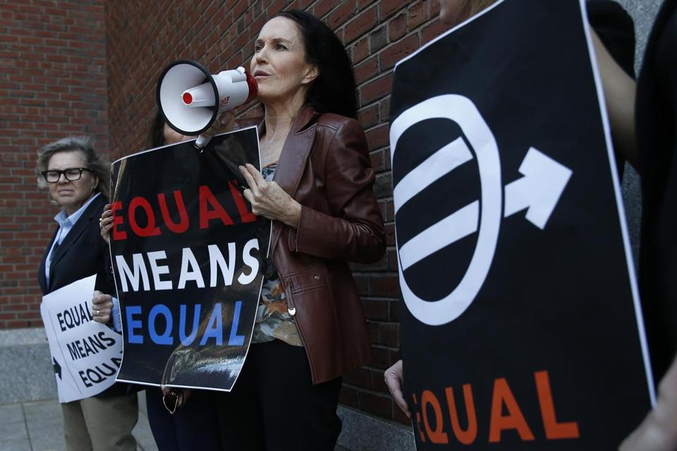 Attorney Wendy Murphy and a small group protested the Trump administration's plan to roll back campus sex assault rules at the Moakley Federal Courthouse in Boston Thursday.