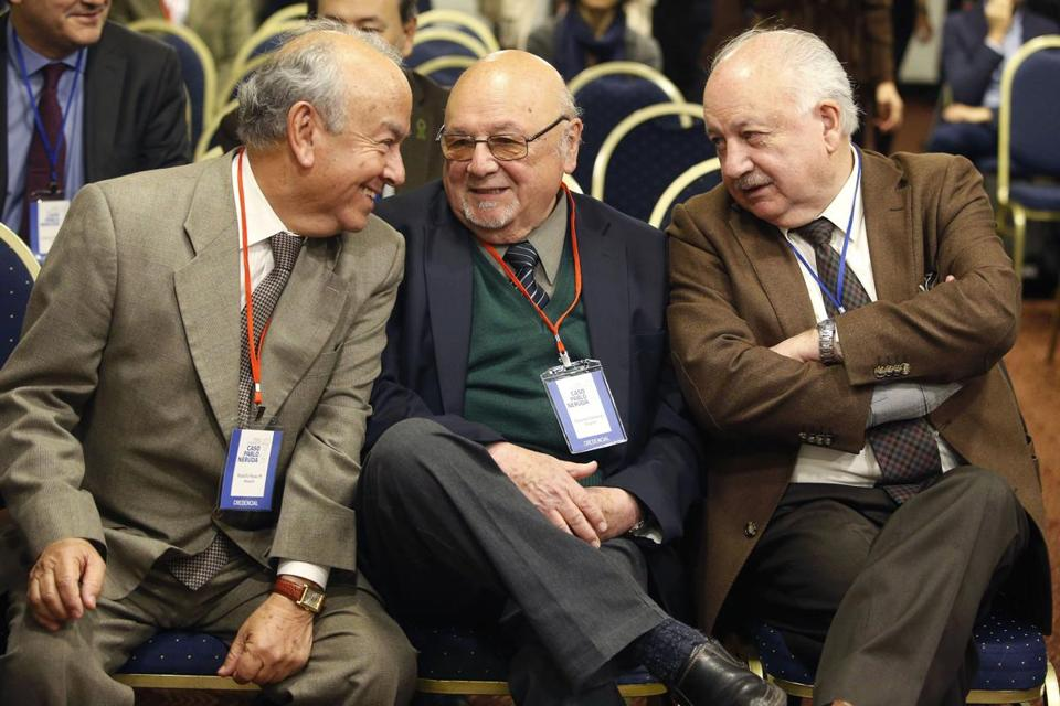 Mandatory Credit: Photo by Elvis Gonzalez/EPA-EFE/REX/Shutterstock (9139294a) The nephew of the poet Pablo Neruda and lawyer, Rodolfo Reyes (L), with lawyer Eduardo Contreras (C) and the president of the Chilean Communist Party, Guillermo Teillier (R) talk during meeting in Santiago, Chile 16 October 2017. A panel of experts from Chile, Spain, United States, Denmark, Canada and France meet to explore the possibility that Chilean poet-diplomat Pablo Neruda was poisoned by the dictatorship of Augusto Pinochet or died due to prostate cancer. Neruda won the Nobel prize for literature in 1971 and died in 1973. Experts explore possibility poet Pablo Neruda was poisoned by Pinochet government, Santiago, Chile - 16 Oct 2017