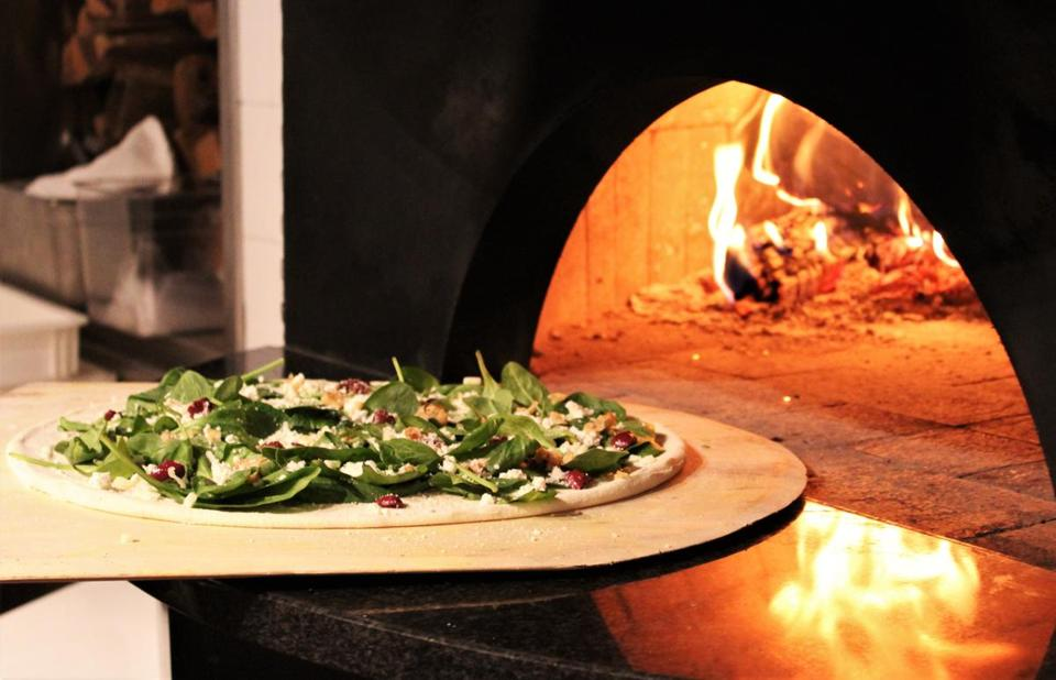 29nodine - The West Coast (mozzarella, fig jam, prosciutto, blue cheese, Peppadew, onion, arugula) is baked in a wood-fired oven. (JackÕs Coal Fired Pizza)