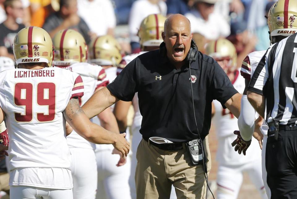 Boston College head coach Steve Addazio welcomes his team back to the bench after a score during the second half of an NCAA college football game against Virginia in Charlottesville, Va., Saturday, Oct. 21, 2017. (AP Photo/Steve Helber)