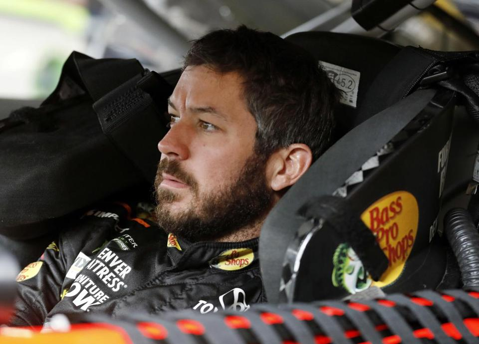 Points leader Martin Truex Jr., prepares for a practice run for the NASCAR Cup Series auto race at Kansas Speedway in Kansas City, Kan., Saturday, Oct. 21, 2017. (AP Photo/Colin E. Braley)
