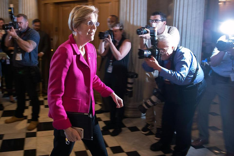 US Senator Elizabeth Warren walked past photographers on her way to the Senate chamber for a vote.