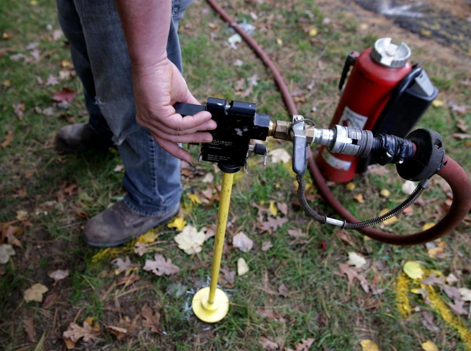 Columbia Gas Crews used a new device called a FluxBar to detect gas leaks in Pembroke. The tool was developed by a clean energy group in Cambridge.