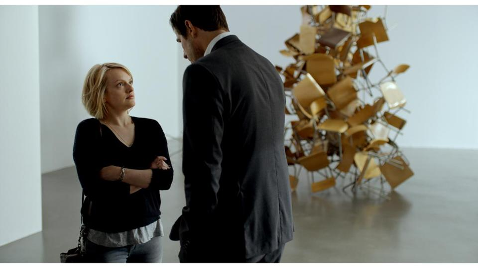 "Elisabeth Moss and Claes Bang in ""The Square."""