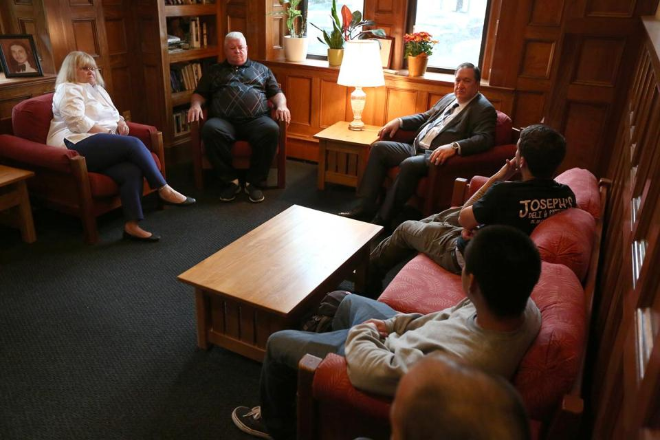 Boston, MA - 10/25/2017 - From left to right, rear, counselors Kathy Connors (cq) and Jimmy Kane (cq), and president/CEO John P. McGahan (cq) chat with some residents, after their morning group session, in the Shaw Room. A partnership between Norfolk County Sheriff Michael Bellotti (cq), Quincy Drug Court Judge Mary Beth Heffernan (cq) and the Gavin Foundation (cq) allows people in drug court, who violate their probation, to be assigned to the foundation's long-term residential treatment centers. Gavin House is located in South Boston. (Pat Greenhouse/Globe Staff) Topic: sodrugrehab Reporter: Jill Ramos