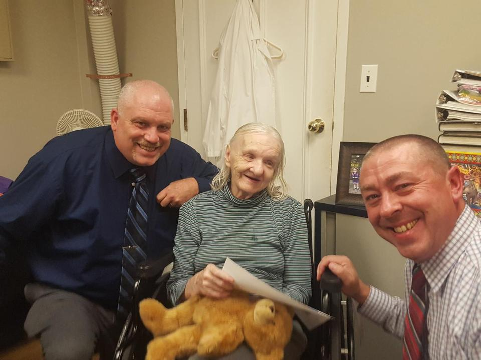 Flora Harris with Sullivan County sheriff's detectives Ed Clouse (left) and Rich Morgan.