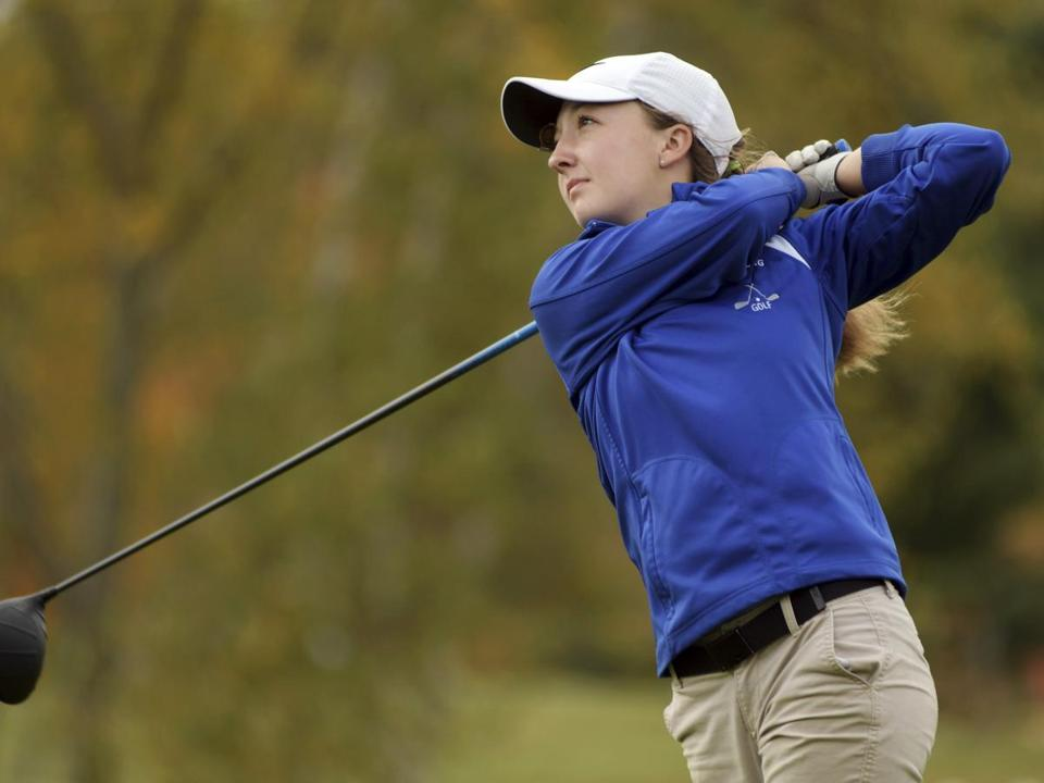 In this Tuesday, Oct. 24, 2017, photo, Lunenburg High School's Emily Nash tees off during the Central Massachusetts Division 3 boys' golf tournament at Blissful Meadows in Uxbridge, Mass. Nash, who had the best score at a boys' golf tournament in Massachusetts, has been denied the trophy because she's a girl. (Christine Peterson/Worcester Telegram & Gazette via AP)