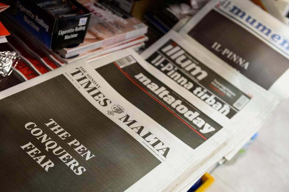 "Maltese newspapers' front pages read, in English and Maltese langage, ""The Pen Conquers Fear"" on October 22, 2017 at a newstand in Valletta, Malta, as a common act of defiance following the assassination of blogger Daphne Caruana Galizia on October 16. The initial shock at the car bomb assassination is now turning into demands for a united front -- with tens of thousands, party allegiance aside, expected at a national rally on October 22 demanding justice for the journalist. / AFP PHOTO / Matthew MirabelliMATTHEW MIRABELLI/AFP/Getty Images"