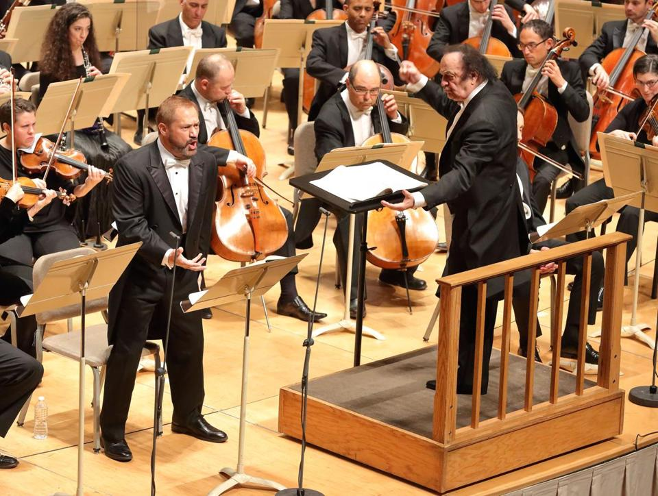 Charles Dutoit (right) conducting the Boston Symphony Orchestra in October.