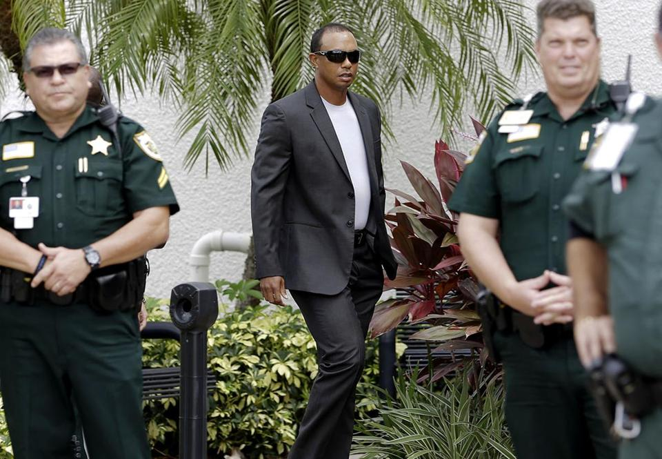 Golfer Tiger Woods arrives at the Palm Beach County courthouse, Friday, Oct. 27, 2017, in Palm Beach Gardens, Fla. Woods has pleaded guilty to reckless driving and agreed to enter a diversion program to settle a charge of driving under the influence. (AP Photo/Alan Diaz)