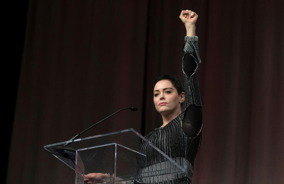 US actress Rose McGowan raises her fist during her opening remarks to the audience at the Women's March / Women's Convention in Detroit, Michigan, on October 27, 2017. A stream of actress including Rose McGowan, models and ex-employees have come out, many anonymously, to accuse Hollywood producer Harvey Weinstein of sexual harassment and abuse dating as far back as the 1990s. / AFP PHOTO / RENA LAVERTYRENA LAVERTY/AFP/Getty Images