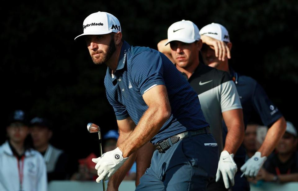 SHANGHAI, CHINA - OCTOBER 28: Dustin Johnson of the United States watches his shot from the 16th tee as Brooks Koepka of the United States and Justin Rose of England look on during the third round of the WGC - HSBC Champions at Sheshan International Golf Club on October 28, 2017 in Shanghai, China. (Photo by Scott Halleran/Getty Images)