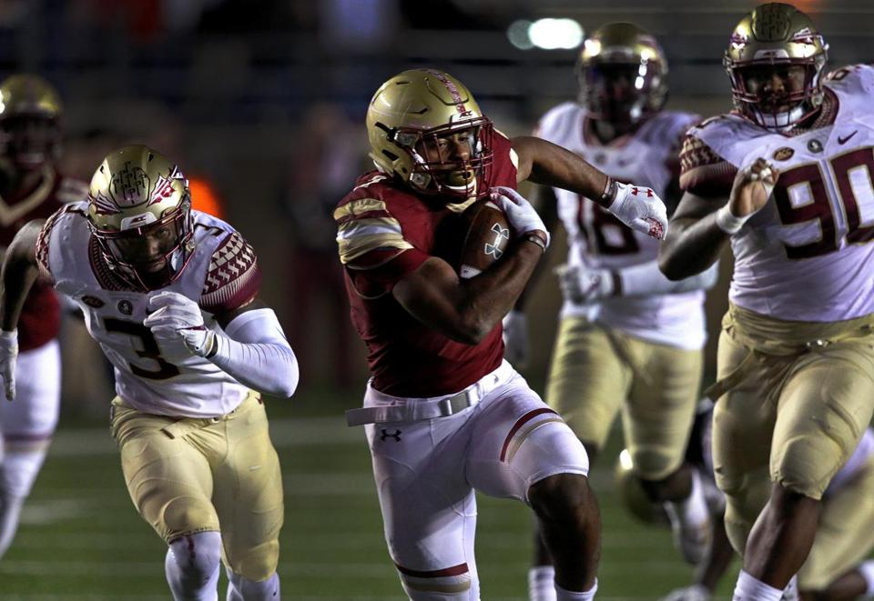 Chestnut Hill, MA - 10/27/2017 - (2nd quarter) Boston College Eagles running back AJ Dillon (2) breaks loose for a long run for a first down leaving a host of Florida State Seminoles defenders in his wake. Boston College hosts Florida State at Alumni stadium. - (Barry Chin/Globe Staff), Section: Sports, Reporter: Julian Benbow, Topic: 28BC-Florida State, LOID:8.3.4153954472.
