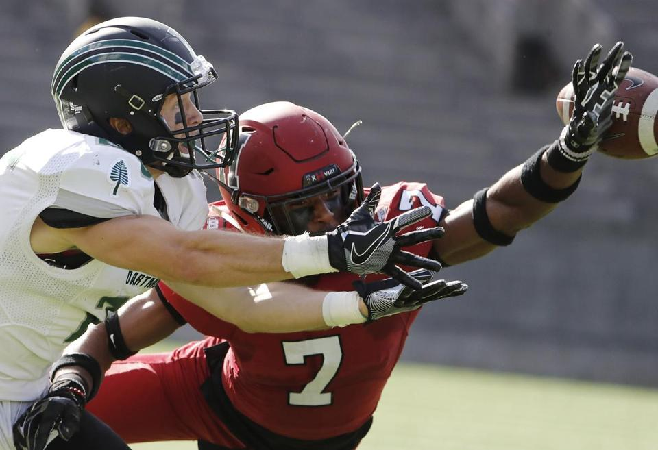 Harvard Crimson cornerback Raishaun McGhee (7) breaks up a pass intended Dartmouth Big Green wide receiver Drew Estrada during their football game at Harvard Stadium in Allston, Mass., Saturday, Oct. 28, 2017. (Winslow Townson for The Boston Globe)