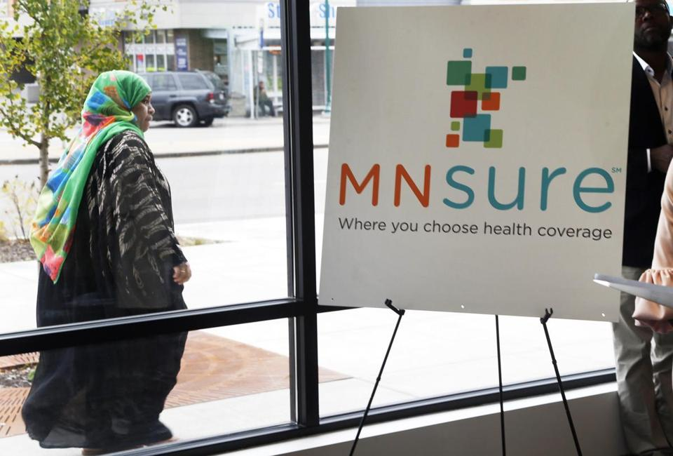 A woman walked past the Briva Health enrollment office for MNsure, Minnesota's insurance marketplace, in Minneapolis.