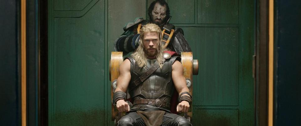 "Chris Hemsworth (seated) returns as the god of thunder in ""Thor: Ragnarok."""