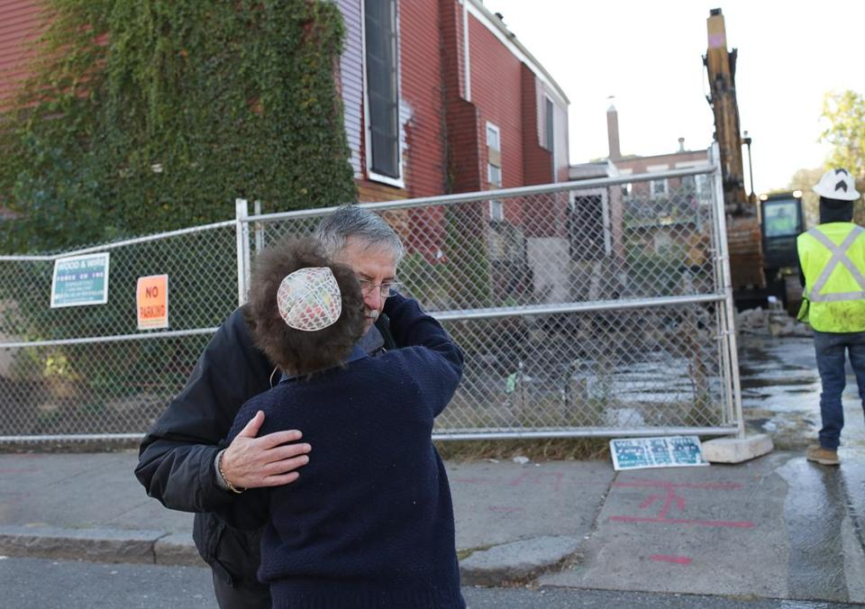 Ira Novoselsky, president of the Congregation Tifereth Israel Synagogue, was hugged by Anne Steinman after a brief ceremony to honor the history of the synagogue.